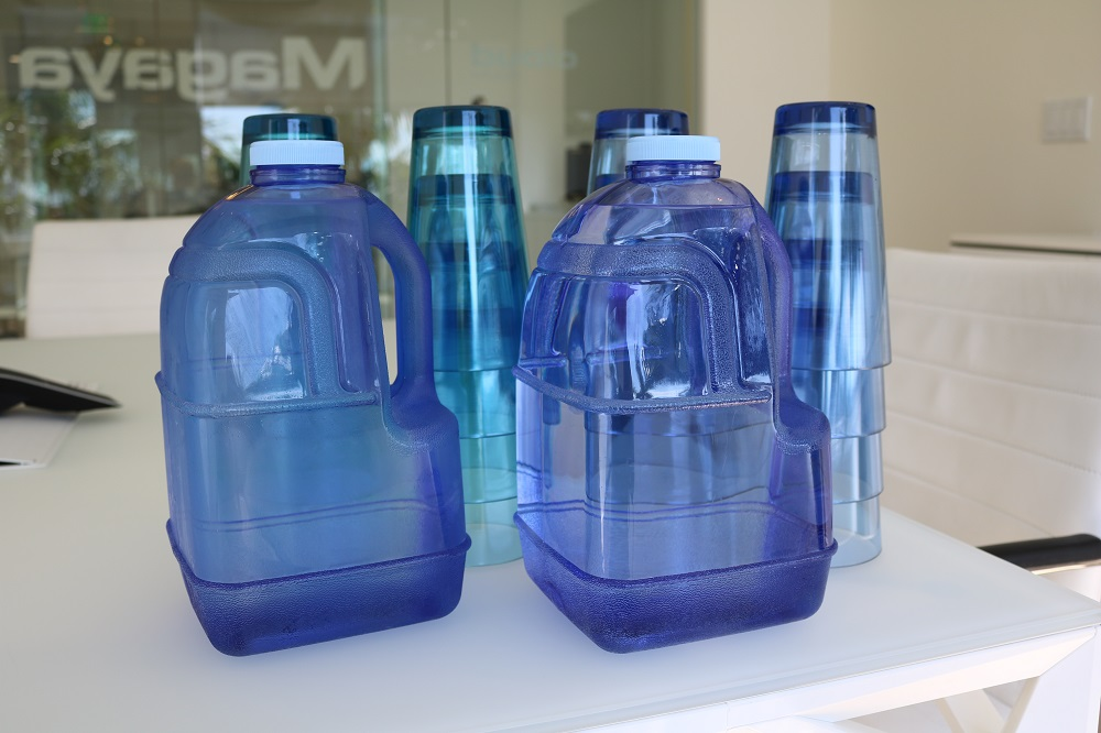 Disposable water bottles were replaced with reusable cups and jugs